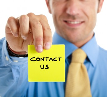 man holding post it with contact us