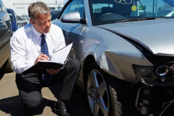 Insurance agent doing a diminished value vehicle appraisal